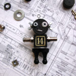 Black 14 Robot Ornament by Trilby Works