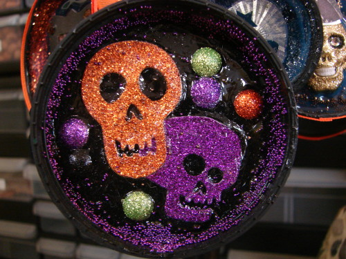 Upcycled Halloween Ornament Made From Metal and Plastic Container Lids
